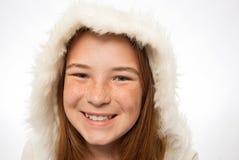 年轻红色朝向的孩子特写镜头皮大衣的 免版税库存图片