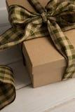 关闭在桌上的被栓的礼物盒 免版税图库摄影