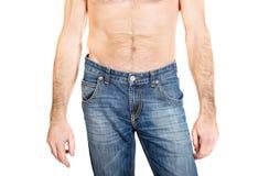 关闭在牛仔裤长裤的赤裸上身的人 免版税库存图片