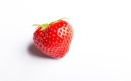 关闭在白色背景的一个草莓 库存照片