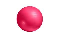 关闭在白色背景隔绝的一个桃红色健身球 免版税图库摄影