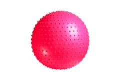 关闭在白色背景隔绝的一个桃红色健身球 库存图片