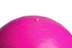 关闭在白色背景隔绝的一个桃红色健身球 免版税库存照片