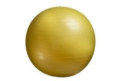 关闭在白色背景隔绝的一个黄色健身球 库存图片