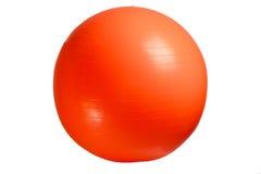 关闭在白色背景隔绝的橙色健身球 库存照片