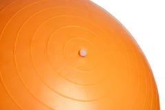 关闭在白色背景隔绝的橙色健身球 免版税图库摄影