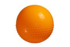 关闭在白色背景隔绝的橙色健身球 库存图片