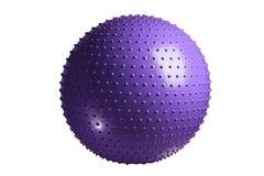 关闭在白色背景隔绝的紫罗兰色健身球 图库摄影