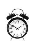 关闭在白色(闹钟)隔绝的一个黑响铃时钟 免版税图库摄影