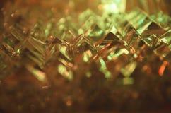 关闭在神奇琥珀灯的被切开的水晶 免版税库存图片