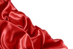 关闭在红色丝织物的波纹 缎纺织品背景 免版税库存照片