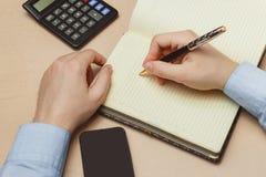 关闭在纸笔记本或老日志的偶然人文字 免版税图库摄影