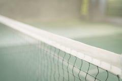 关闭在羽毛球场的网 (被处理的被过滤的图象 库存照片