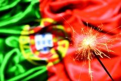 关闭在葡萄牙,葡萄牙旗子的闪烁发光物燃烧 假日,庆祝,党概念 免版税库存图片