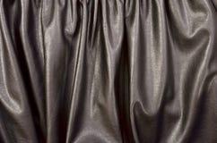 关闭在被弄皱的黑皮革材料被构造的织品 图库摄影