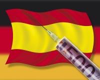 关闭在西班牙旗子的现金射入反对德国旗子 库存图片