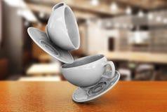 关闭在餐馆3d r的背景的一个白色杯子 库存照片