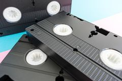 关闭在3个黑VHS录影带说谎 图库摄影