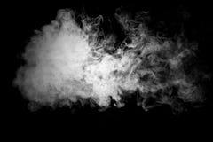 关闭在黑背景的蒸汽烟 库存图片