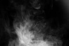 关闭在黑背景的蒸汽烟 免版税库存照片