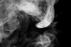 关闭在黑背景的蒸汽烟 图库摄影