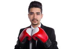 关闭在黑衣服和红色拳击手套的成功的商人 库存照片