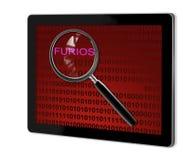 关闭在furios的放大镜 免版税库存照片
