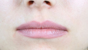 关闭女性嘴唇 免版税库存照片