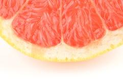 关闭射击一半在白色背景的葡萄柚 库存照片