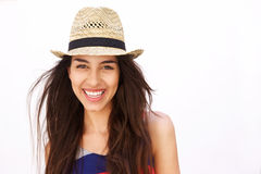 关闭微笑与帽子的一个西班牙女孩的画象 库存图片