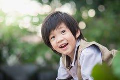 关闭愉快的亚裔孩子 免版税库存图片