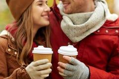 关闭愉快的加上咖啡在秋天 库存图片
