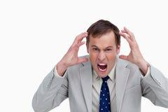 关闭愤怒的叫喊的生意人 免版税库存图片