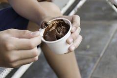关闭手的图象有冰淇凌的 库存照片