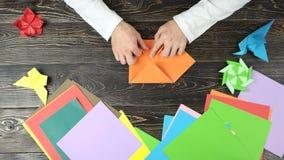 关闭折叠origami形象的男性手 影视素材