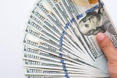 关闭拿着一百元钞票的金钱手 免版税图库摄影