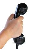 关闭拿着电话的手 免版税库存照片