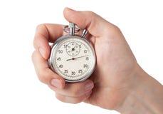 关闭拿着秒表的手,隔绝在白色背景 免版税库存照片