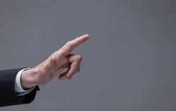 关闭指向手指看法  库存照片