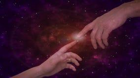 关闭接触与手指的人的手当在宇宙背景的米开朗基罗手 股票录像