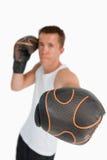 关闭攻击拳头的拳击手 免版税库存照片