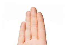 关闭显示四个手指的手 免版税库存照片