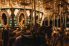 关闭有启发性旋转木马在冬天妙境圣诞节市场在伦敦,英国 免版税库存图片