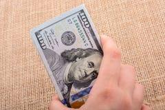 关闭本杰明・富兰克林在美元面对 免版税图库摄影