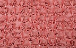 关闭桃红色纺织品吹背景  图库摄影