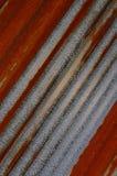 关闭桔子被腐蚀的波状钢板料 库存图片