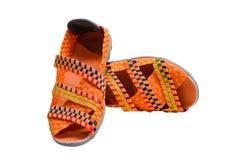 关闭橙色被隔绝的颜色有弹性鞋子 免版税库存图片
