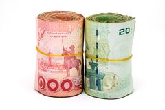 关闭泰国货币,与泰国国王的图象的泰铢 20泰铢和100泰铢的衡量单位 免版税库存照片