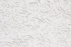 关闭灰泥白色破裂的墙壁照片在照片的 免版税库存图片