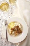 关闭烤肋条肉和意大利煨饭 免版税库存照片